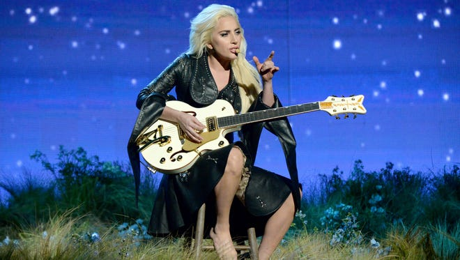 Lady Gaga, who is pictured performing at this year's American Music Awards, gave an emotional interview to 'CBS Sunday Morning.'