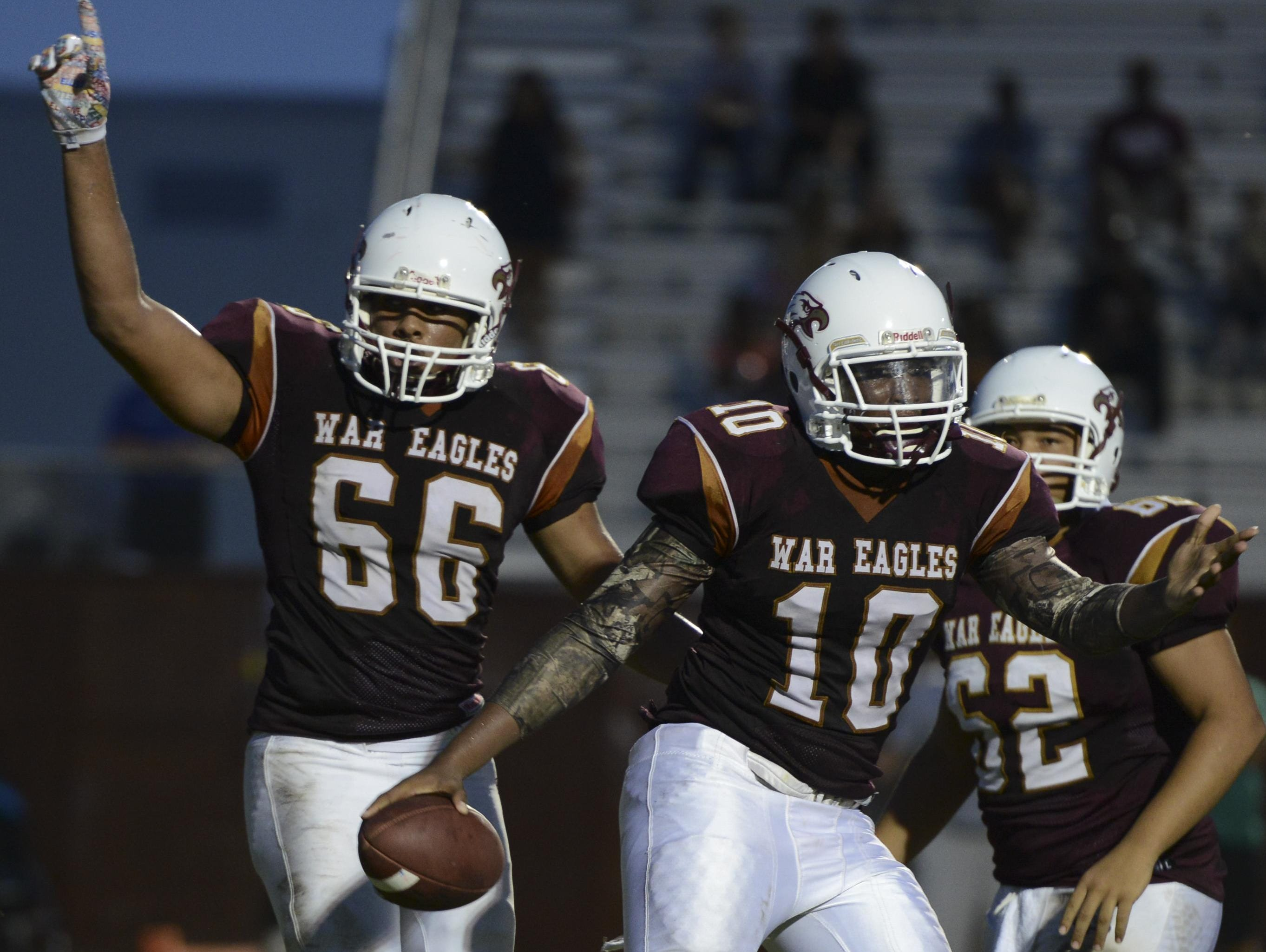 Astronaut players Harry Hampton (66) Jamairius Seigler (10) and Nico Wallace could celebrate a playoff spot by winning Friday.