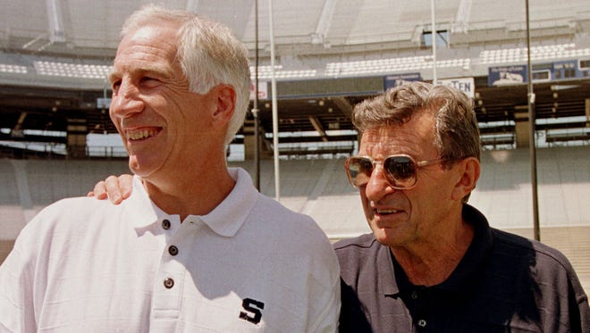 Penn State football coach Joe Paterno, right, poses with defensive coordinator Jerry Sandusky on Aug. 6, 1999.