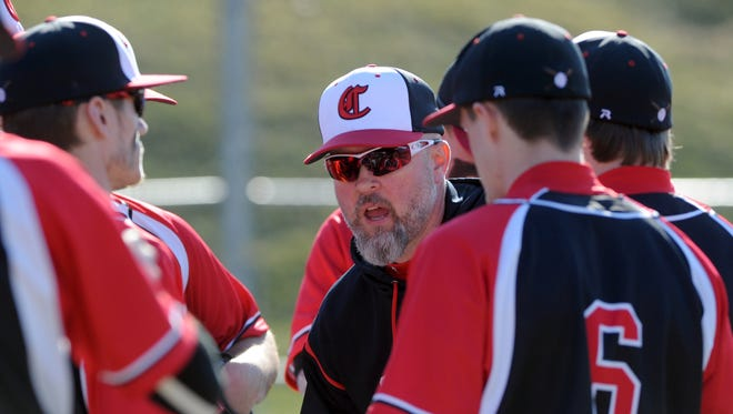 Shawn Chamberlin, Crooksville head coach, talks to his team before the start of a game against John Glenn in New Concord. Chamberlin, who coached baseball for 17 years, was recently hired as the school's new head girls basketball coach.