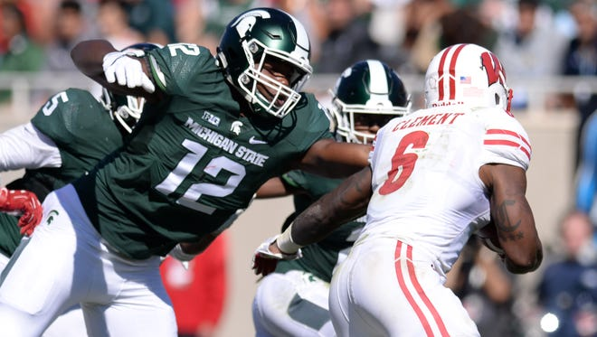 Heralded MSU true freshman defensive end Josh King moves in to tackle Wisconsin running back Corey Clement late in Saturday's game. It was King's first playing time this season.