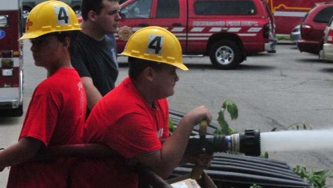 Richmond Fire Department's third Junior Fire Academy began Monday with campers learning the basics of equipment and fighting fires.