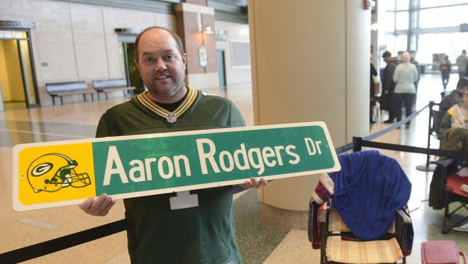 Albert Vetter of Green Bay was first in line Monday to get an Aaron Rodgers autograph. Rodgers signed autographs Monday evening to raise money for the Salvation Army.