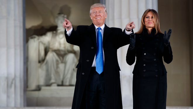 President Donald Trump and his wife, Melania, at the Lincoln Memorial