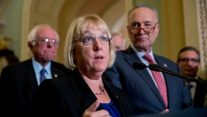 "Sen. Patty Murray, D-Wash., accompanied by Sen. Bernie Sanders, I-Vt., left, and Senate Minority Leader Sen. Chuck Schumer of N.Y., right, speaks to reporters on Capitol Hill in Washington, Tuesday, Oct. 17, 2017, after she and Sen. Lamar Alexander, R-Tenn., say they have the ""basic outlines"" of a bipartisan deal to resume payments to health insurers that President Donald Trump has blocked."