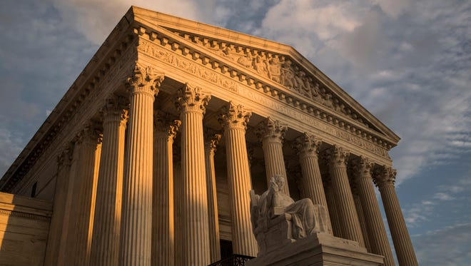 In this Oct. 10, 2017 photo, The Supreme Court in Washington is seen at sunset.