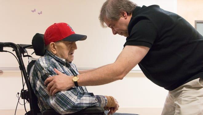 "Nick Bonanno talks with his father, World War II veteran Rosario ""Russ"" Bonanno, inside the VA nursing home in Bedford, Mass."