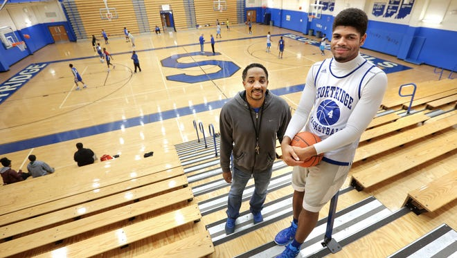 Shortridge's Various Wilson (right) has been sleeping over on school nights with coach Donnie Bowling, left, and is spending weekends with a teammate.