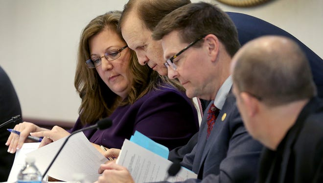 Sue Finkam, Ron Carter, Jeff Worrell and Kevin Rider look over city documents on Jan. 4, 2016.