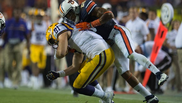 Auburn defensive back Tray Matthews (28) tackles LSU