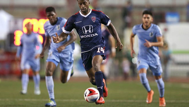 FILE -- Center, Indy Eleven forward Duke Lacroix (14) dribbles down the field in the second half of the Indy Eleven's game against Minnesota United FC at IUPUI's Carroll Stadium, Indianapolis, Saturday, May 21, 2016.
