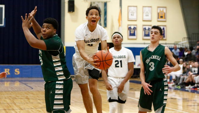 Beacon High School's Brandon Evans drives to the basket during a game against Spackenkill on Dec. 31.