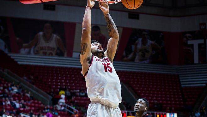 Ball State's Franko House dunks against Bowling Green's defense during their game at Worthen Arena Saturday, Jan. 7, 2017.
