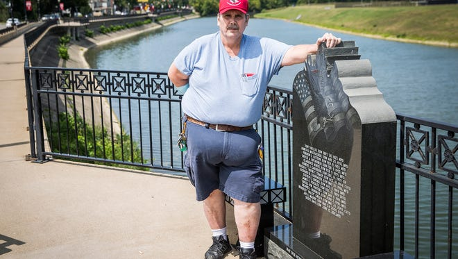 Bill Terrell at the Fallen Heroes Bridge on High Street Friday afternoon.