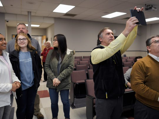 Williamson County Director of Schools Dr. Mike Looney, right, takes a picture of the election results at the Williamson County Administration Complex in Franklin, Tenn. on Tuesday, Feb. 6, 2018.