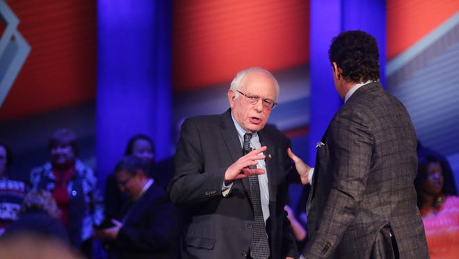 Presidential hopeful, Bernie Sanders talks with CNN's Chris Cuomo during the Democratic Presidential Town Hall forum in Sheslow Auditorium on the Drake University campus Monday evening, Jan. 25, 2016.