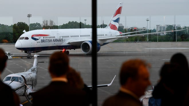 Passengers on British Airways inaugural flight to London watch as their 787 jet is towed to the gate Nashville International Airport Friday, May 4, 2018, in Nashville, Tenn.