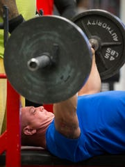 Ben O'Brien works out at Die Hard Gym and Fitness. The Air Force crew chief is training for the Mr. Olympia competition.