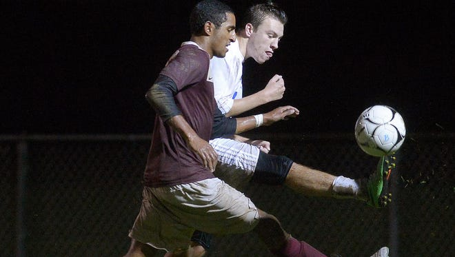 Brockport's Nolan Maines, back, clears the ball away from Pittsford Mendon's Adrian Padilla during a Class A1 quarterfinal game at Brockport High School on Thursday, Oct. 20, 2016. No. 3 seed Brockport beat No. 6 seed Pittsford Mendon 3-0.