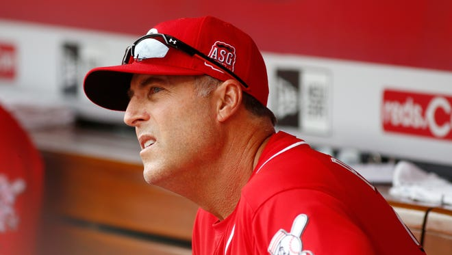 Cincinnati Reds manager Bryan Price looks on from the dugout in the second inning against the Pittsburgh Pirates at Great American Ball Park.