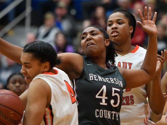 Henderson's Alisha Owens battles for a rebound with