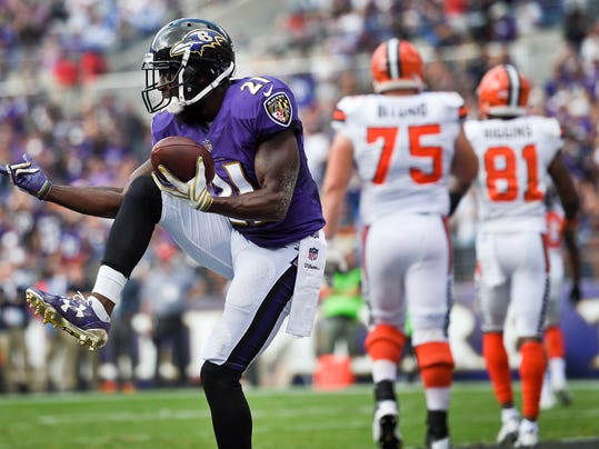 Baltimore Ravens free safety Lardarius Webb (21) celebrates his interception of a pass intended for Cleveland Browns Rashard Higgins (81) during the second half of an NFL football game in Baltimore, Sunday, Sept. 17, 2017. (AP Photo/Nick Wass)