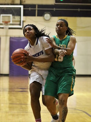 Haywood's Jamirah Shutes (23) goes up for a shot against Bolivar in the Region 8-AA semifinals Monday at Trezevant.