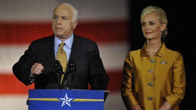Sen. John McCain and wife Cindy address their supporters at the Arizona Biltmore Resort in Phoenix on Nov. 4, 2008, after McCain's defeat in the presidential election.
