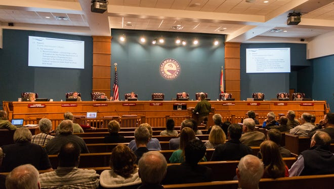 The public fills the Escambia County Commission chambers to speak about a proposed flyover on Nine Mile Road on Thursday, Feb. 1, 2018.