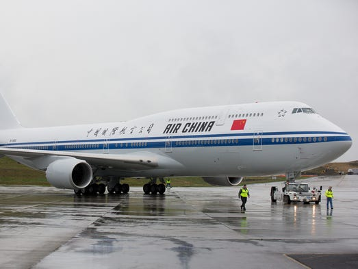 Air China's first Boeing 747-8i is pulled into position for its unveiling ceremony at the Future of Flight museum in Everett, Wash.