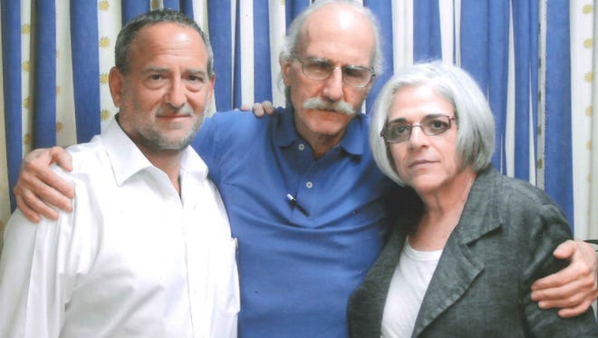 American contractor Alan Gross, center, poses with his wife, Judy, and his attorney, Scott Gilbert, during a visit in a Cuban prison last year.