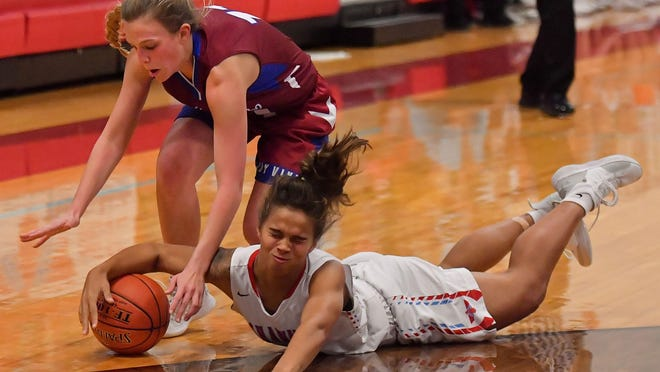 Shawnee Heights' Kam Wells dives for a loose ball for the T-Birds in a game against Seaman. Wells has been named the Topeka Shawnee County most inspirational female for the 2019-20 school year.