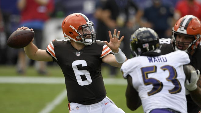 Cleveland Browns quarterback Baker Mayfield (6) looks to pass during an NFL football game against the Baltimore Ravens, Sunday, Sept. 13, 2020, in Baltimore.