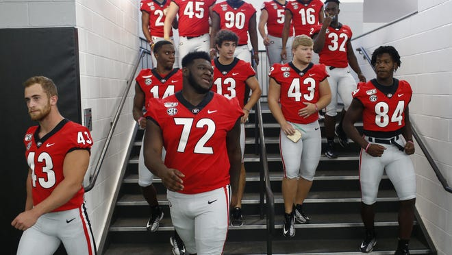 Players arrive to meet and sign autographs with their fans doing Georgia's Football Fan Day at the Payne Indoor Athletic Facility in Athens on Saturday, August 3, 2019.