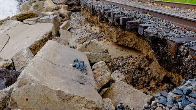 The waves washed away soil around railroad tracks near the International Flag Plaza in Port Huron.