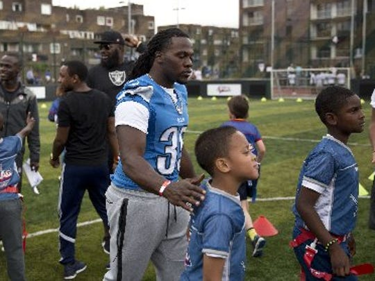 Detroit Lions running back Joique Bell helped London youngsters in an NFL Summer Bowl football tournament at the Black Prince Community Hub on Wednesday.