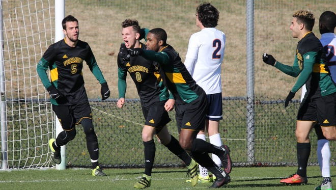Vermont players celebrate the second half goal by Jon Arnar Barddal, second from left, against Virginia during Sunday's NCAA tournament game in Charlottesville, Virginia.