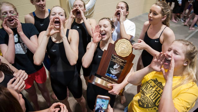 Fossil Ridge High School swimmers celebrate winning the CHSAA Girls 5A State Championships Friday, Feb. 10, 2017 at the Veterans Memorial Aquatics Center in Thornton, CO.