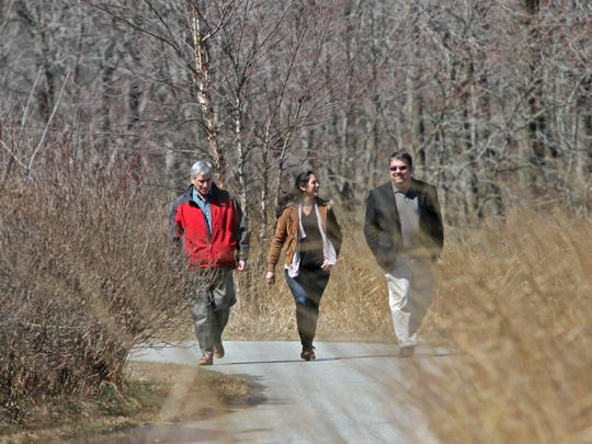 Delaware Greenways staffers Jeffrey L. Green (left), Becca Manning and David Hunt take a walk near the Greenways offices off Rockland Road.