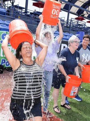 Brrrrr! Carmen Berrios Vasconcelos, Madison, Kerri Olah Brennan and  Pam Olah Brennan take the ice bucket challenge.