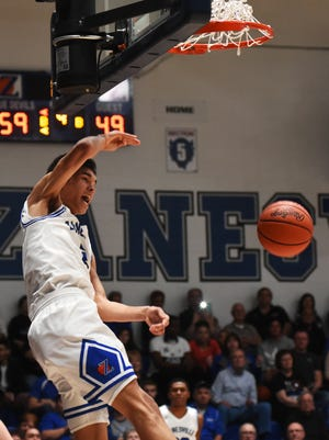Cameron Brooks-Harris throws down a dunk late in the fourth quarter during Zanesville's 63-55 win against visiting New Philadelphia on Friday night at Winland Memorial Gymnasium. Brooks-Harris finished with 19 points, 10 rebounds and four steals.