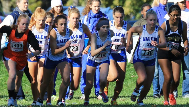 Determination is etched on the faces of these Salem runners as they spring into action at the county meet.