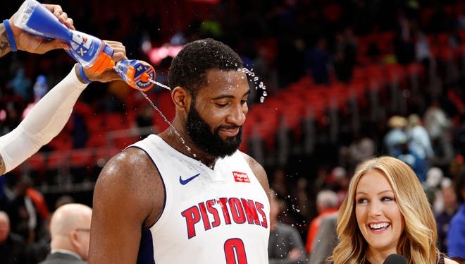 Andre Drummond is showered with water by a teammate, after a Pistons win over the Wizards on March 29 at Little Caesars Arena.