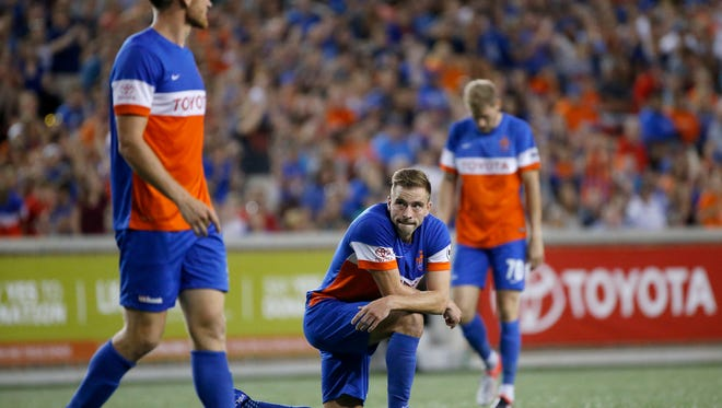 FC Cincinnati Matt Bahner (2) takes a knee after a shot doesn't meet the net in the second half of the USL soccer match between FC Cincinnati and Orlando City B at Nippert Stadium in Cincinnati on Saturday, Aug. 5, 2017. Despite a goal late in stoppage time, FC Cincinnati settled for a tie against OCB.