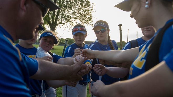 Castle's team huddle up after defeating North at Castle High School on Friday, May 11, 2018. Castle defeated North 11-0 in the sixth inning.