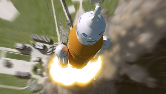 Artist rendering shows an aerial view of NASA's Space Launch System rocket lifting off from pad 39B at Kennedy Space Center.