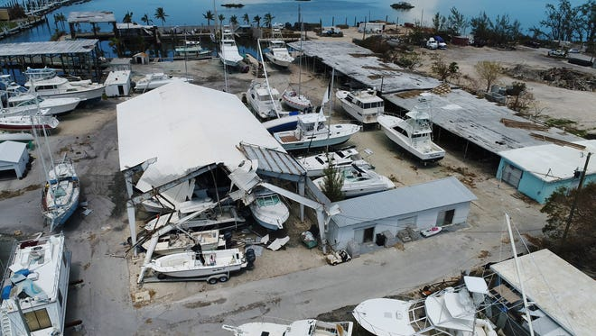 A damaged boat barn can be seen in Marathon, Fla. after hurricane Irma swept through the Florida Keys, Sept. 14, 2017.