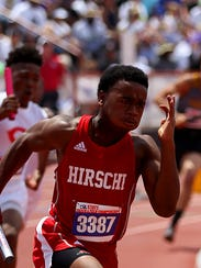 Hirschi's Nate Downing competes int he Class 4A boys 4x100 relay Saturday during the UIL Track & Field Championships held at Mike Myers Stadium in Austin.