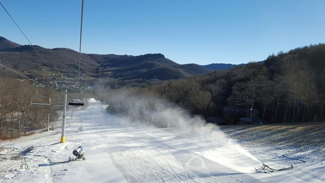 Snow blowers attempt to make snow at Sugar Mountain in this photo taken Dec. 10. The ski area in Avery County has been closed because of warm temperatures since Friday, but with the upcoming freeze expected this week, managers hope to be open by the weekend.
