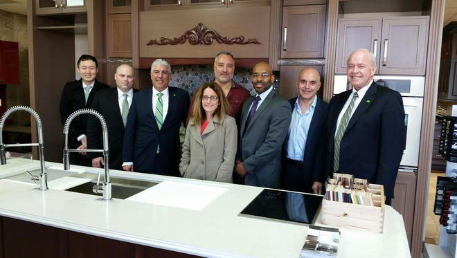 TD Bank executives and Aldo Design principals gather for the closing of the first loan of the New Jersey Advantage Program with the state Economic Development Authority.